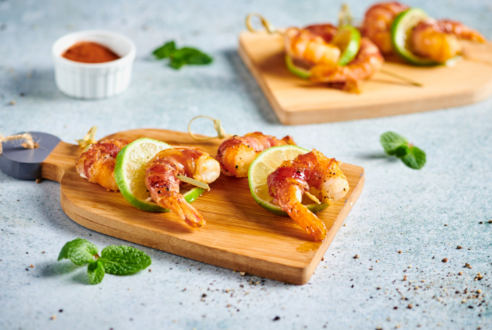 Pancetta-wrapped prawns with curry mayonnaise